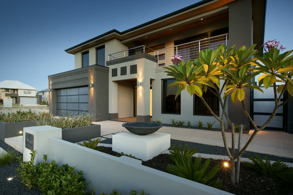 Beautiful modern house with a frangipani in the front yard