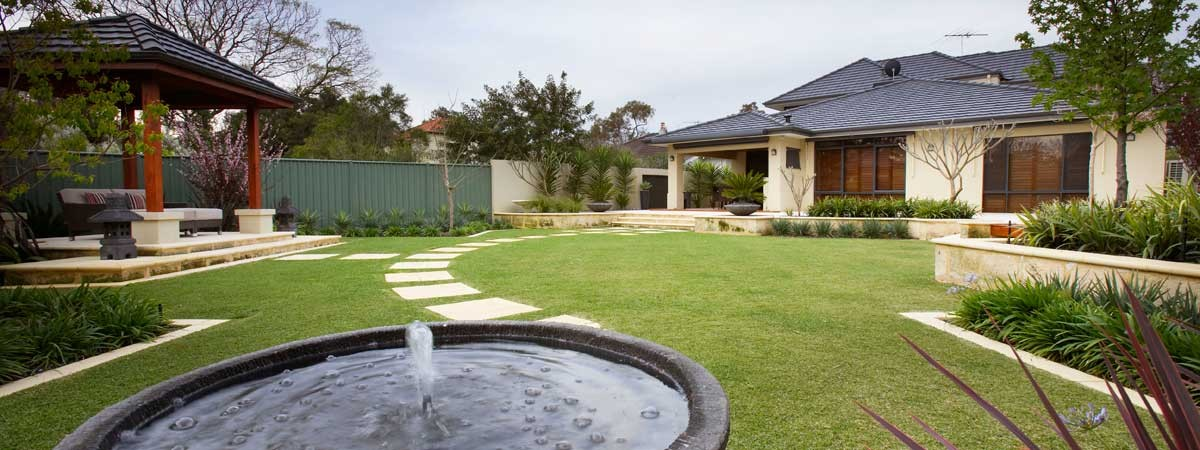 Image showing a bubbling fountain set amongst a beautifully landscaped yard including a custom built gazebo