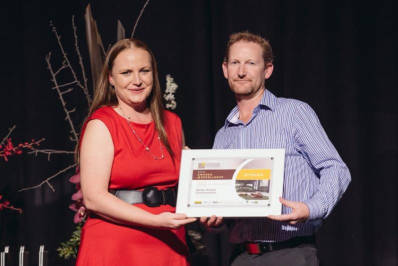 Deep Green Landscaping- Julian accepting award