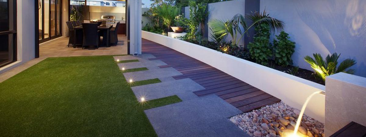 Image showing landscape yard with water feature, decking and grass