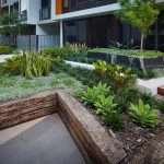 LIV Apartments raised garden beds with benches