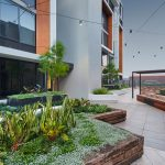 LIV Apartments path between garden and benches
