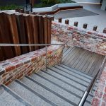 LIV Apartments looking down brick staircase